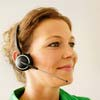 Woman with telephone headset on